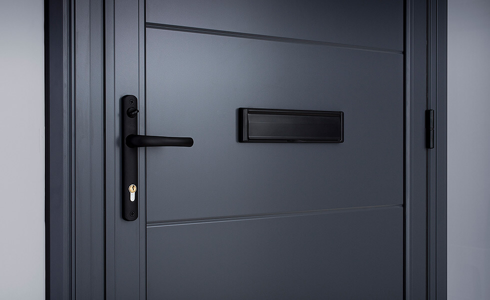 Grey aluminium front door handle and letterbox