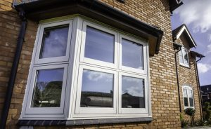 White uPVC flush sash bay window