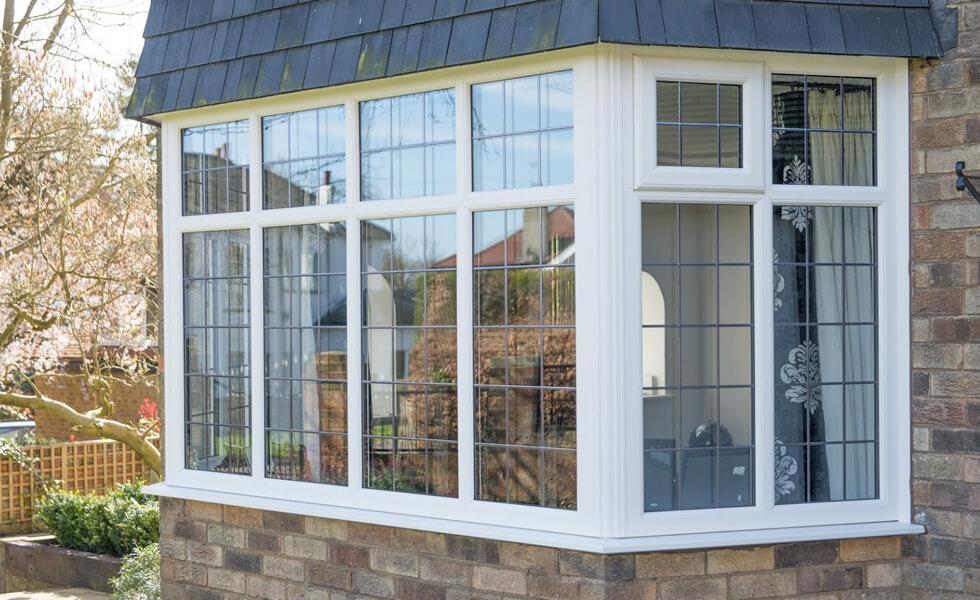 White uPVC bay windows with leaded glass