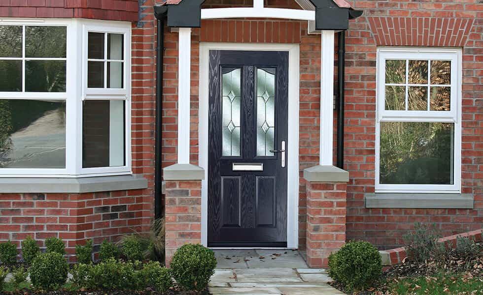 Dark blue composite front door installation