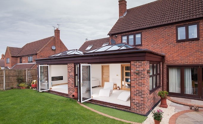 brick and brown frame double conservatory